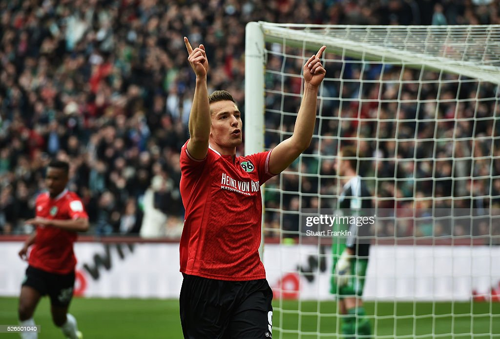Artur Sobiech of Hannover celebrates scoring his goal during the Bundesliga match between Hannover 96 and FC Schalke 04 at the HDI Arena on April 30, 2016 in Hanover, Lower Saxony.