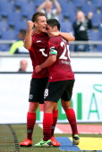 Artur Sobiech of Hannover celebrates with teammate Lars Stindl after scoring their teams second goal during the Bundesliga match between Hannover 96...