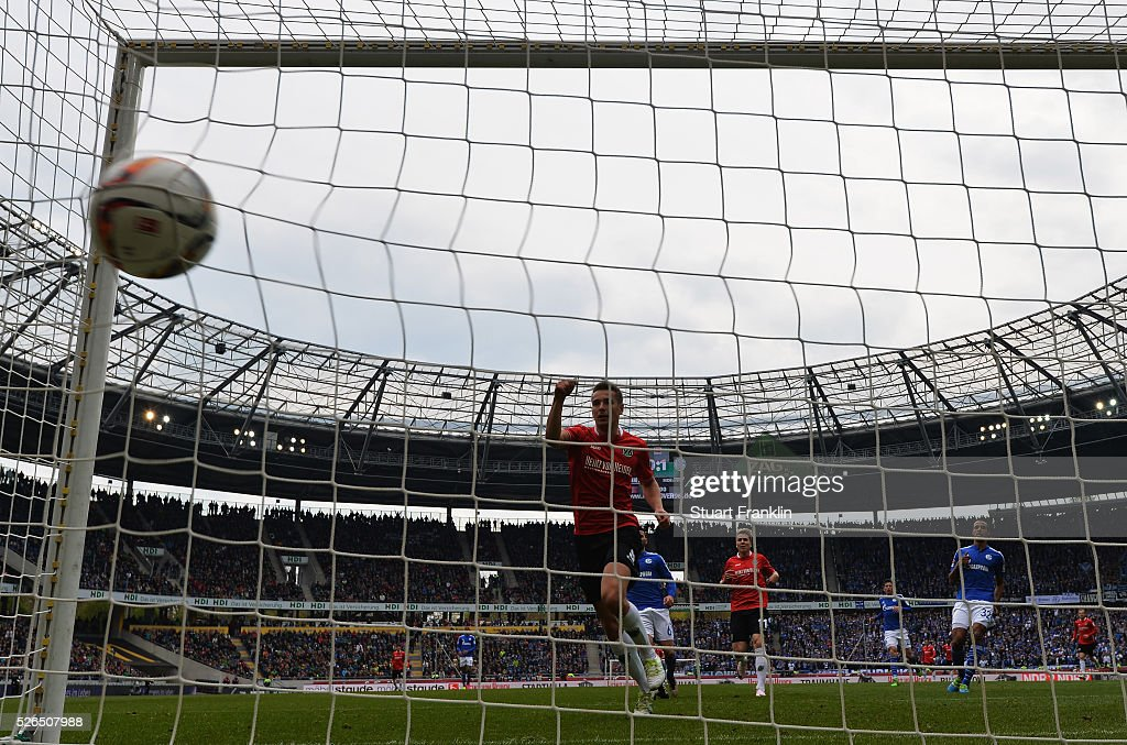 Artur Sobiech of Hannover scores his goal during the Bundesliga match between Hannover 96 and FC Schalke 04 at the HDI Arena on April 30, 2016 in Hanover, Lower Saxony.