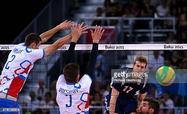 Artur Szalpuk of Poland scores a point during the Men's Volleyball quarter final match against Slovakia on day twelve of the Baku 2015 European Games...