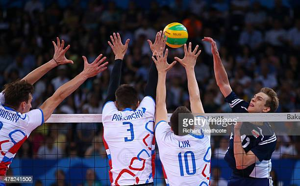 Artur Szalpuk of Poland spikes the ball against Slovakia during the Men's Volleyball Quarter Final match on day twelve of the Baku 2015 European...