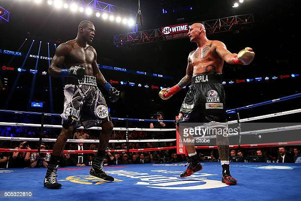 Artur Szpilka reacts against Deontay Wilder during their WBC Heavyweight Championship bout at Barclays Center on January 16 2016 in Brooklyn borough...