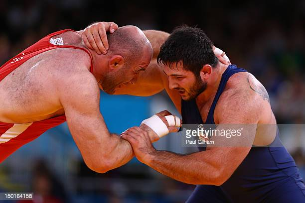 Artur Taymazov of Uzbekistan and Davit Modzmanashvili of Georgia compete for the bronze medal in the Men's Freestyle 120 kg Wrestling on Day 15 of...