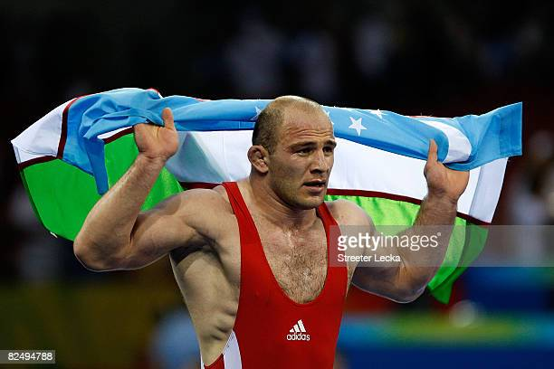 Artur Taymazov of Uzbekistan celebrates after winning the gold medal match of the Men's 120kg Freestyle wrestling against Bakhtiyar Akhmedov of...