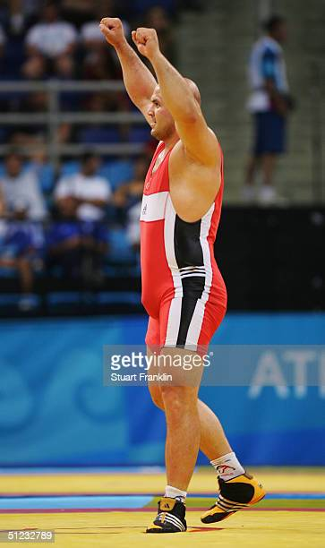 Artur Taymazov of Uzbekistan celebrates defeating Alireza Rezaei of Iran in the men's Freestyle wrestling 120 kg gold medal match on August 28 2004...