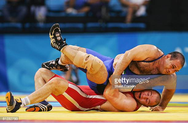 Artur Taymazov of Uzbekistan competes against Alireza Rezaei of Iran in the men's Freestyle wrestling 120 kg gold medal match on August 28 2004...