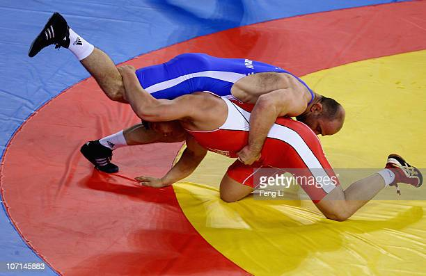 Artur Taymazov of Uzbekistan competes with Jargalsaikhan Jargalsaikhan of Mongolia in the Men's Freestyle 120 kg Finals at Huagong Gymnasium during...