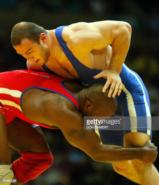 Artur Taymazov of Uzbekistan looks for a grip on Kerry McCoy of the US in the 120 kg catagory 14 September 2003 at the World Freestyle Championships...