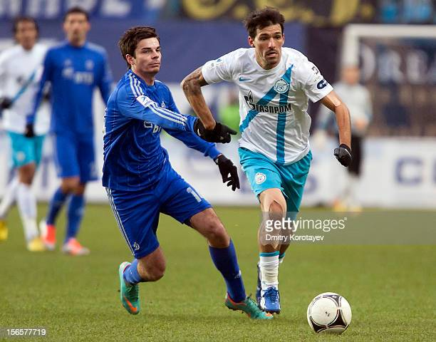 Artur Yusupov of FC Dynamo Moscow battles for the ball with Danny of FC Zenit St Petersburg during the Russian Premier League match between FC Dynamo...