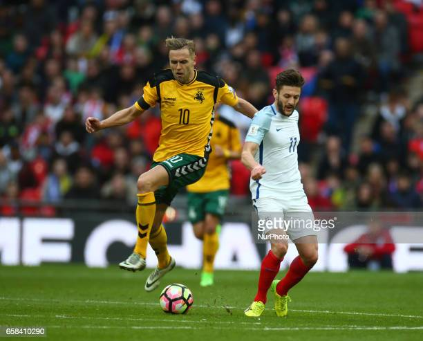 LR Arturas Zulpa of Lithuania and England's Adam Lallana during FIFA World Cup Qualfying European Group F match between England against Lithuania at...