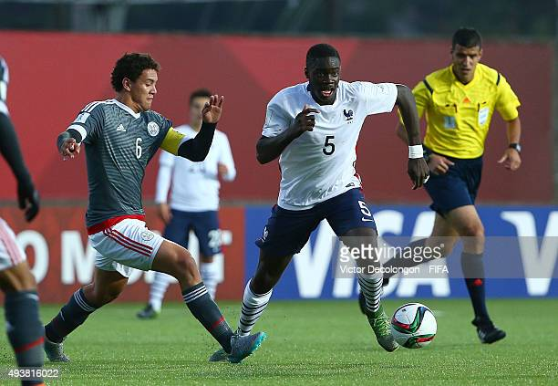 Arturo Aranda of Paraguay and Dayotchanculle Upamecano of France vie for the ball during the Paraguay v France Group F FIFA U17 World Cup Chile 2015...