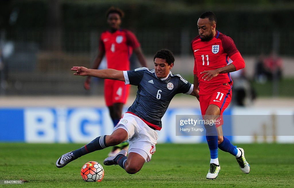 Arturo Aranda of Paraguay is tackled by <a gi-track='captionPersonalityLinkClicked' href=/galleries/search?phrase=Nathan+Redmond&family=editorial&specificpeople=6489095 ng-click='$event.stopPropagation()'>Nathan Redmond</a> of England during the Toulon Tournament match between Paraguay and England at Stade Antoinr Baptiste on May 25, 2016 in Six-Fours-Les-Plages, France.
