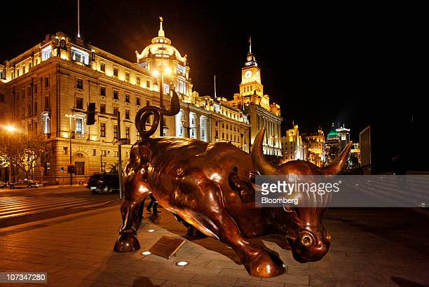 Arturo Di Modica's 'the Bund Financial Bull' sculpture stands on the Bund in Shanghai China on Saturday Dec 4 2010 The artist Arturo Di Modica also...
