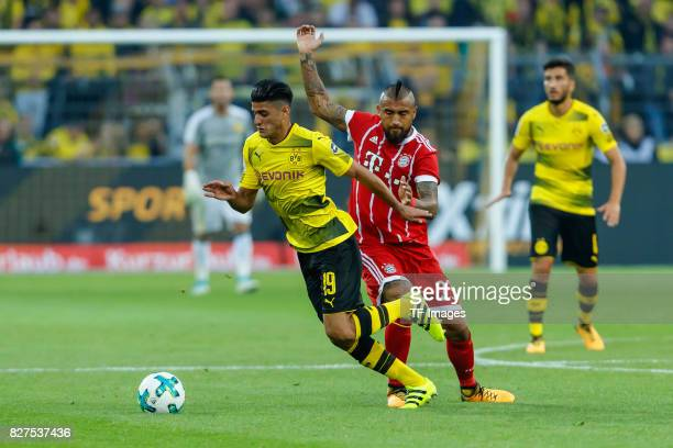 Arturo Erasmo Vidal of Bayern Muenchen and Mahmoud Dahoud of Dortmund battle for the ball during the DFL Supercup 2017 match between Borussia...
