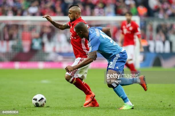 Arturo Erasmo Vidal of Bayern Muenchen and Walace Souza Silva of Hamburg battle for the ball during the Bundesliga match between Bayern Muenchen and...