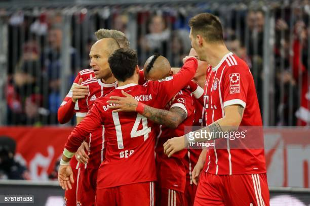Arturo Erasmo Vidal of Bayern Muenchen celebrates after scoring his team`s first goal with team mates during the Bundesliga match between FC Bayern...