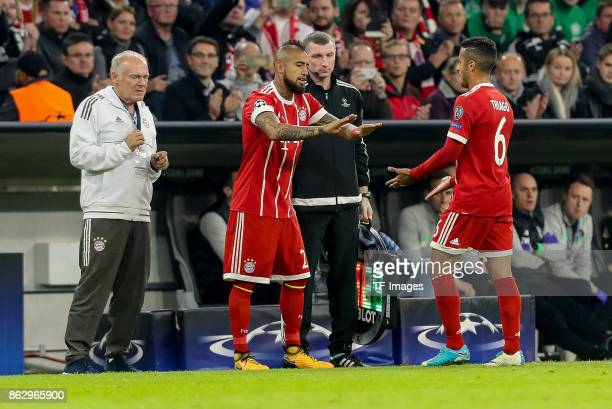 Arturo Erasmo Vidal of Bayern Muenchen shakes hands with Thiago Alcantara of Bayern Muenchen during the UEFA Champions League group B match between...
