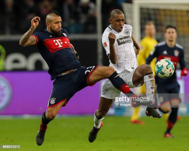Arturo Erasmo Vidal of Muenchen and Gelson da Conceicao Tavares Fernandes of Frankfurt battle for the ball during the Bundesliga match between...