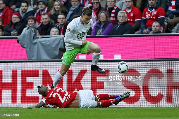 Arturo Erasmo Vidal of Muenchen and Yannick Gerhardt of Wolfsburg battle for the ball during the Bundesliga match between Bayern Muenchen and VfL...