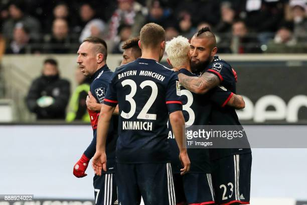 Arturo Erasmo Vidal of Muenchen celebrates after scoring his team`s first goal with team mates during the Bundesliga match between Eintracht...