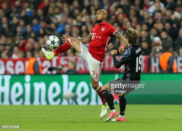 Arturo Erasmo Vidal of Munich and Luka Modric of Real Madrid battle for the ball during the UEFA Champions League Quarter Final first leg match...