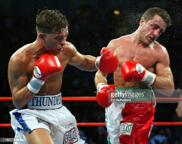 Arturo Gatti lands a big left hook to the head of Gianluca Branco during their 12 round fight for the vacant WBC Junior Welterweight Championship...