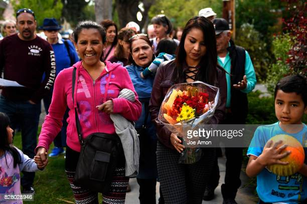 Arturo Hernandez Garcia and Jeanette Vizguerra walking with Ingrid Encalada Latorre safely from the Mountain View Friends Meeting after she was...