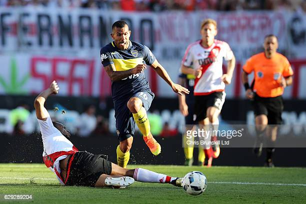 Arturo Mina Meza of River Plate challenges Carlos Tevez of Boca Juniors during the Argentine Primera Division match between River Plate and Boca...
