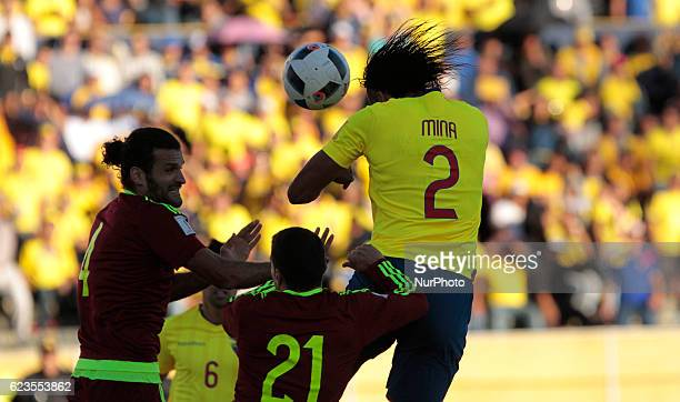 Arturo Mina of Ecuador and Alexander Gonzalez of Venezuela battle for the ball during a match between Ecuador and Venezuela as part 2018 FIFA World...