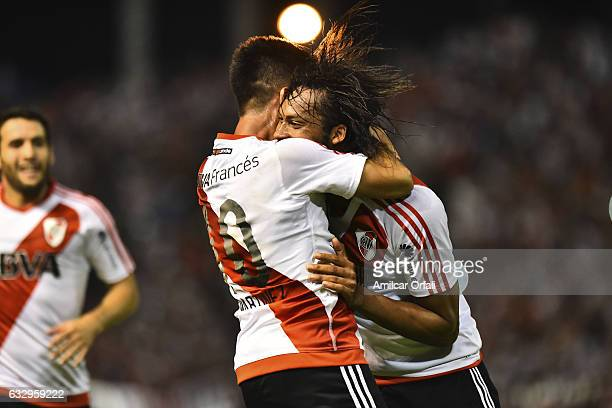 Arturo Mina of River Plate celebrates with teammate Gonzalo Martinez after scoring the second goal of his team during a match between Boca Juniors...
