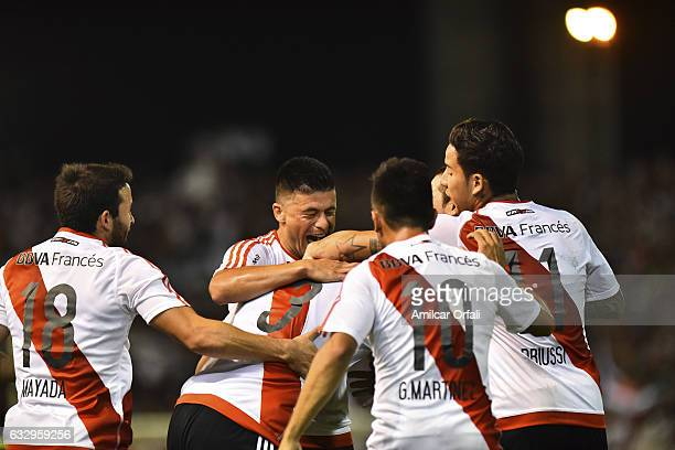 Arturo Mina of River Plate celebrates with teammates after scoring the second goal of his team during a match between Boca Juniors and River Plate as...