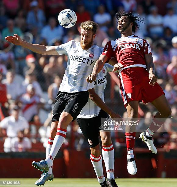 Arturo Mina of River Plate fights for the ball with Jonatan Schunke of Estudiantes during a match between River Plate and Estudiantes as part of...
