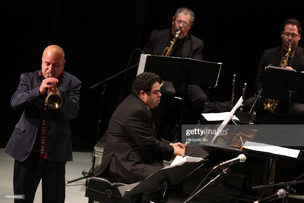 Arturo O'Farrill and the Afro Latin Jazz Orchestra performing at Symphony Space on Friday night, November 2, 2012.This image:The guest trumpeter Steven Bernstein with the musical director Arturo O'Farrill on piano.