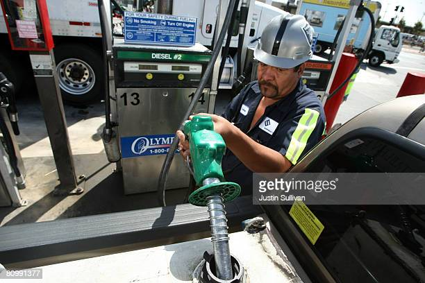 Arturo Santana pumps fuel into a storage tank in the back of his work truck May 5 2008 in San Francisco California US gas prices have shot up nearly...