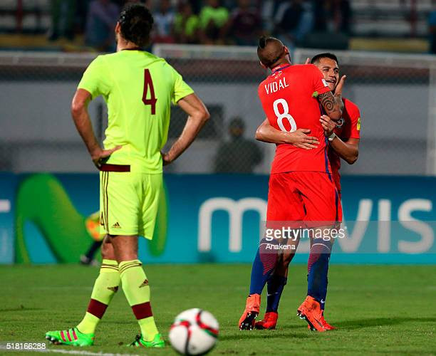 Arturo Vidal and Alexis Sanchez celebrate the fourth goal of their team during a match between Venezuela and Chile as part of FIFA 2018 World Cup...