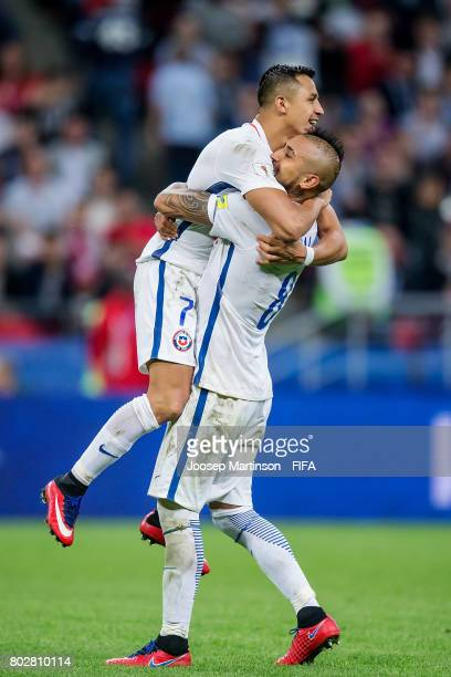 Arturo Vidal and Alexis Sanchez of Chile celebrate after scoring a penalty kick in the penalty shootout during FIFA Confederations Cup Russia...