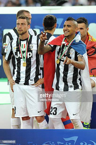 Arturo Vidal and Claudio Marchisio of Juventus celebrate winning the Serie A Championships at the end of the Serie A match between Juventus and...