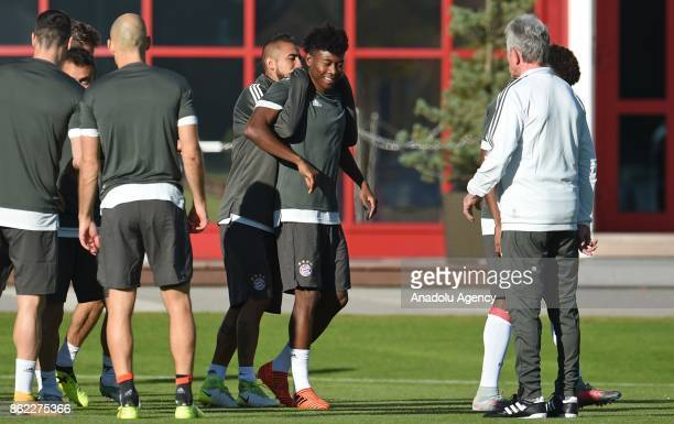 Arturo Vidal and David Alaba of FC Bayern Munich attend a training session ahead of the Champions League group B match between Bayern Munich and...