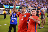 Arturo Vidal and Gary Medel of Chile celebrate after winning the championship match between Argentina and Chile at MetLife Stadium as part of Copa...
