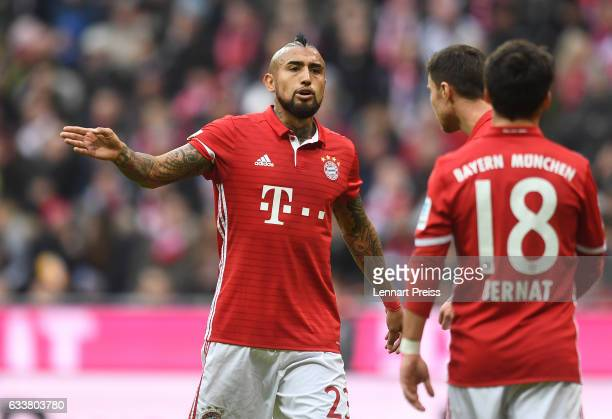 Arturo Vidal and Juan Bernat talk to each other during the Bundesliga match between Bayern Muenchen and FC Schalke 04 at Allianz Arena on February 4...