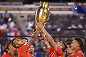 Arturo Vidal and Mauricio Isla of Chile celebrate with the trophy after winning the championship match between Argentina and Chile at MetLife Stadium...