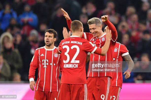 Arturo Vidal and Robert Lewandowski of FC Bayern Muenchen celebrate their teams third goal during the Bundesliga match between FC Bayern Muenchen and...
