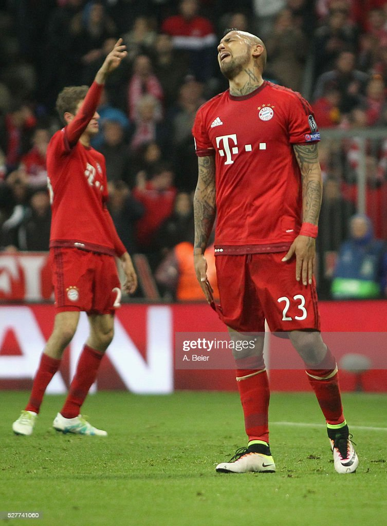 Arturo Vidal (R) and Thomas Mueller of Bayern Muenchen react during the Champions League semi final second leg match between FC Bayern Muenchen and Club Atletico de Madrid at Allianz Arena on May 3, 2016 in Munich, Germany.