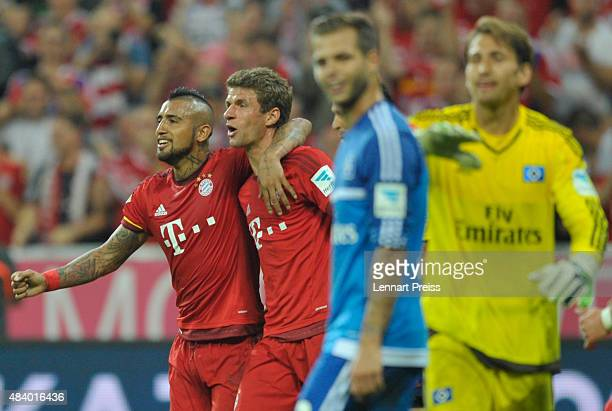 Arturo Vidal and Thomas Mueller of FC Bayern Muenchen celebrate scoring their team's fourth goal during the Bundesliga match between FC Bayern...