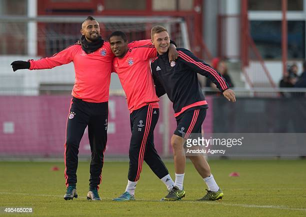 Arturo Vidal Douglas Costa and Joshua Kimmich of Bayern Munich attend a training session ahead the UEFA Champions League group F football match...