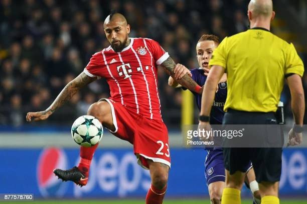 Arturo Vidal midfielder of Bayern Adrien Trebel midfielder of RSC Anderlecht during the UEFA Champions League group B match between RSC Anderlecht...