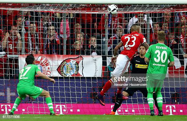 Arturo Vidal of Bayern heads the opening goal during the Bundesliga match between Bayern Muenchen and Borussia Moenchengladbach at Allianz Arena on...