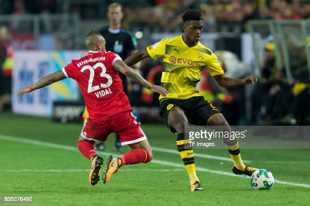 Arturo Vidal of Bayern Muenchen and DanAxel Zagadou of Dortmund battle for the ball during the DFL Supercup 2017 match between Borussia Dortmund and...