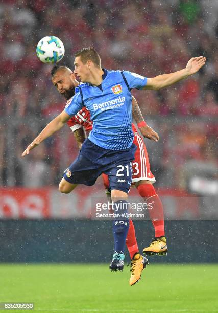 Arturo Vidal of Bayern Muenchen and Dominik Kohr of Bayer Leverkusen during the Bundesliga match between FC Bayern Muenchen and Bayer 04 Leverkusen...