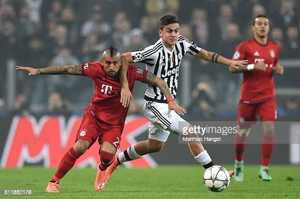 Arturo Vidal of Bayern Muenchen and Paulo Dybala of Juventus battle for the ball during the UEFA Champions League round of 16 first leg match between...